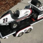 Scale model race car and trailer